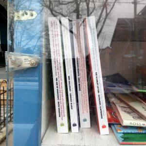 Gladstone Press books inside a community little library in Beaconsfield Village neighbourhood of Toronto.